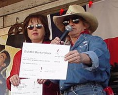 Susan Matassa presenting the proceeds to Teresa Bullard of the East Texas Crisis Center.  $900 was raised from proceeds related to the Chili Cook-off  and the Buffalo Girls personally donated $300, making  the GRAND TOTAL, $1,200 ! ! !